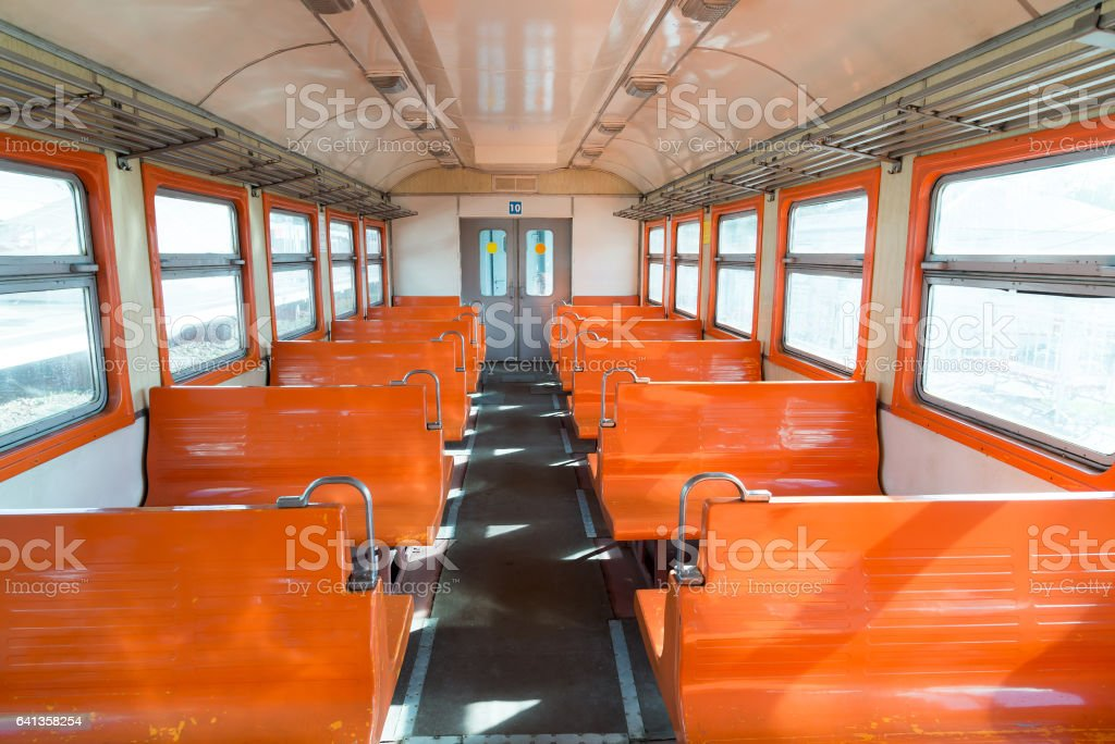 Orange suburban electric train in Moscow, Russia stock photo
