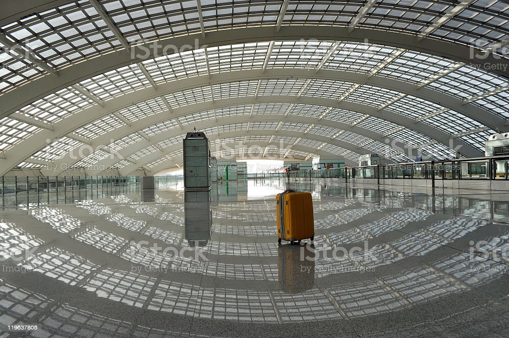 Orange Suitcase in Beijing Airport royalty-free stock photo