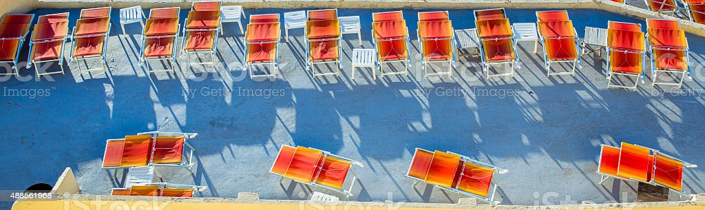 orange sunbeds at a terrace at the Corniche in Marseille stock photo