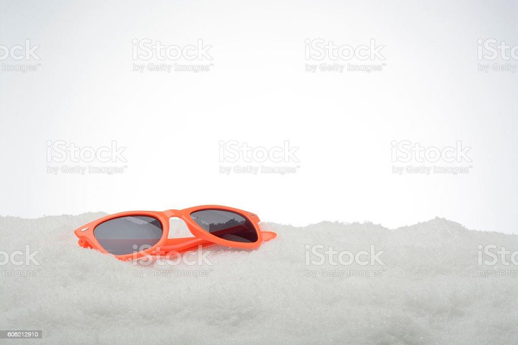 Orange sunglasses on Snow stock photo