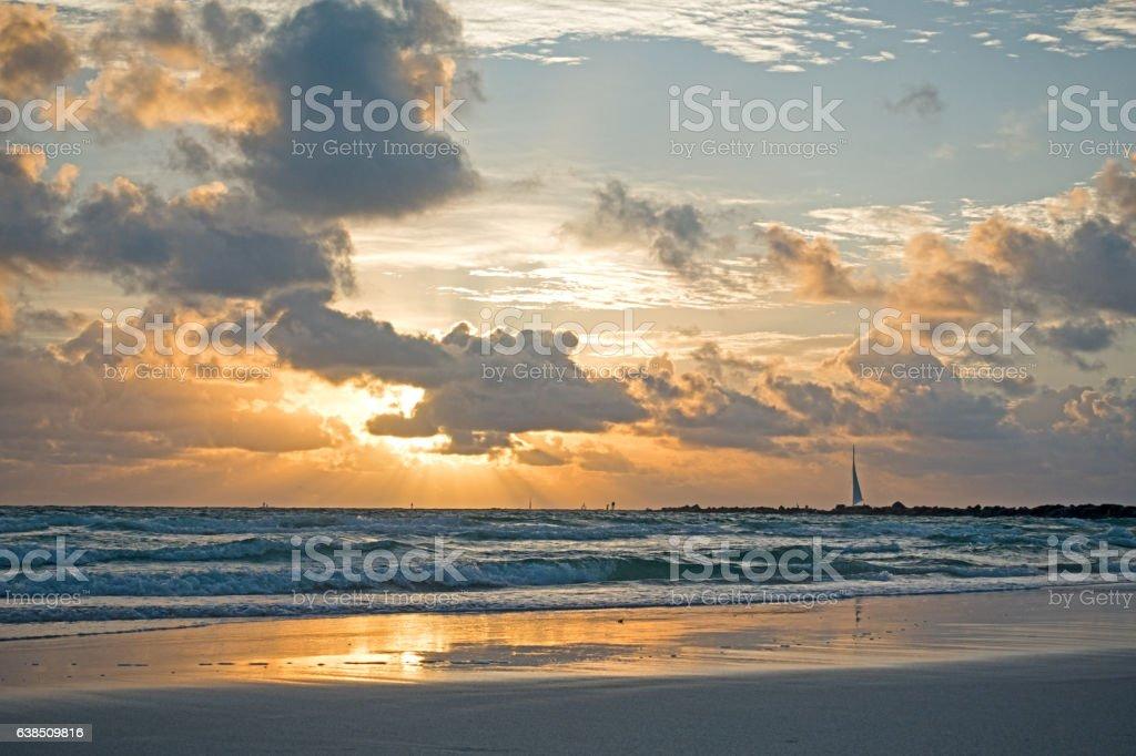 Orange Sunrays Through Clouds Miami South Beach stock photo