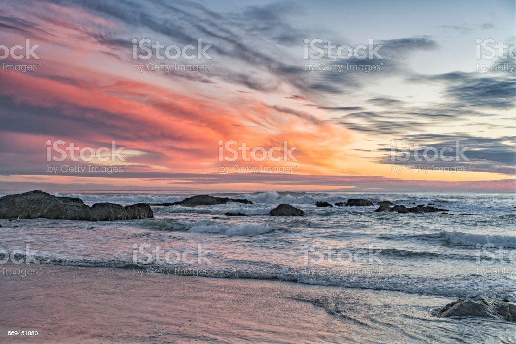 Orange sunset at the beach. stock photo
