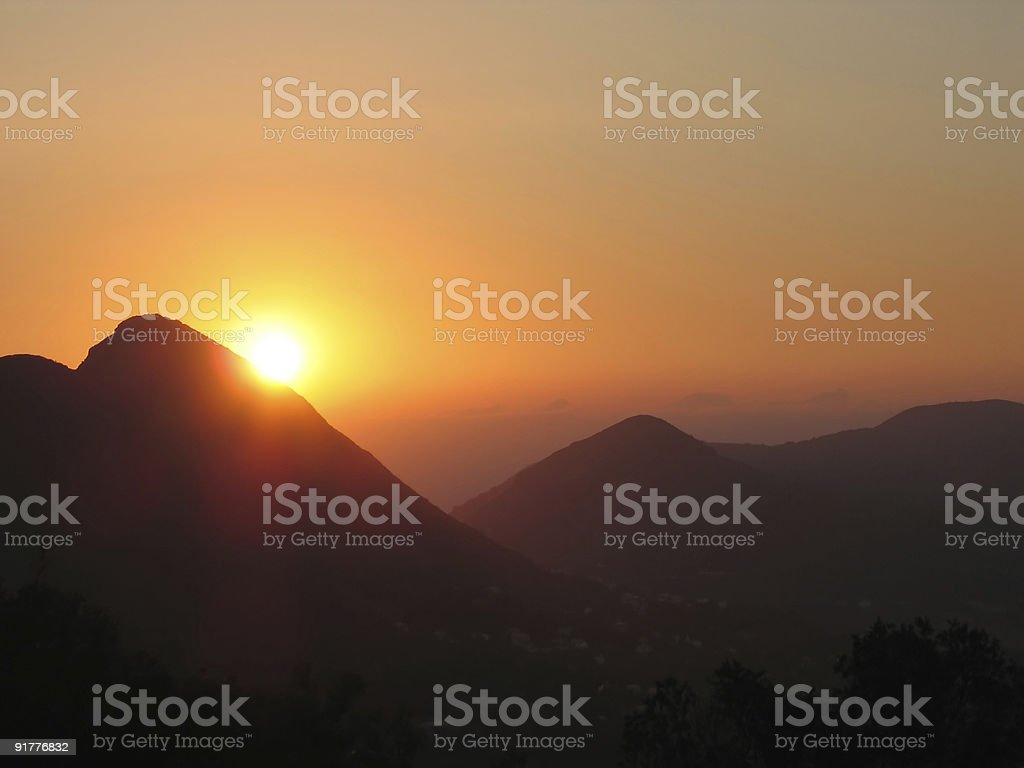 Orange sunset in the mountains royalty-free stock photo