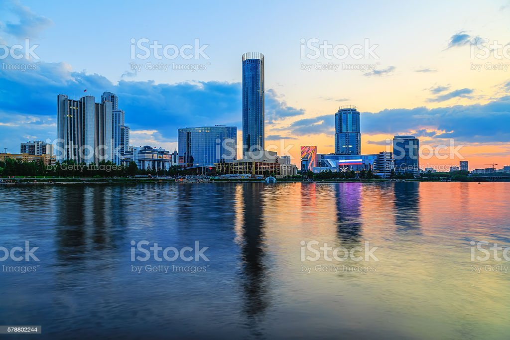 orange sunset over city pond and business part  city  Yekaterinburg stock photo