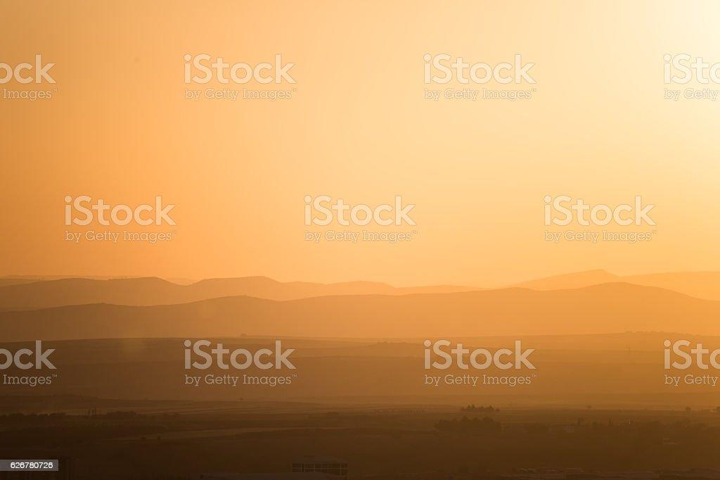Orange sunset over the cliffs stock photo