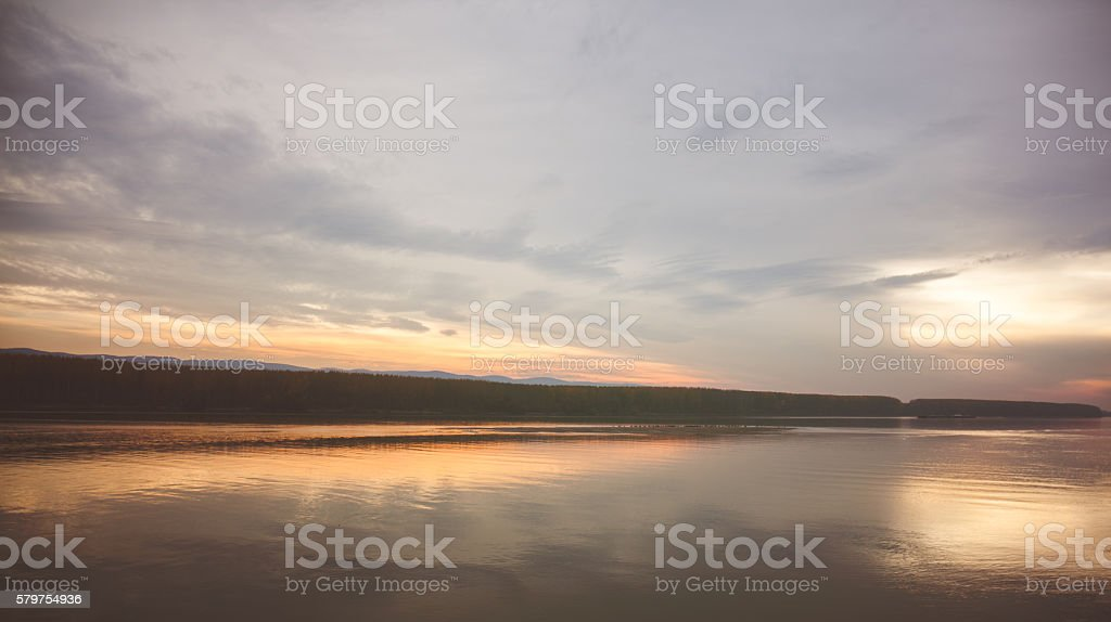 Orange sunset reflected stock photo