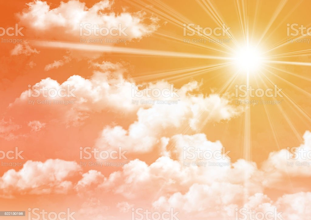 orange sunset sky with clouds and sun rays stock photo