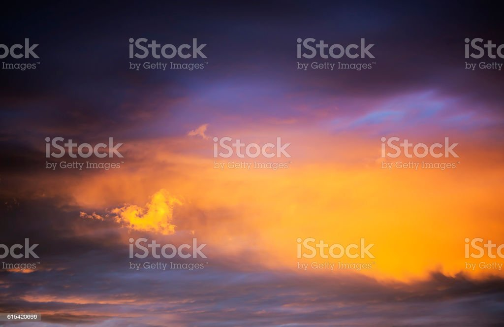 Orange sunset with a small cloud stock photo