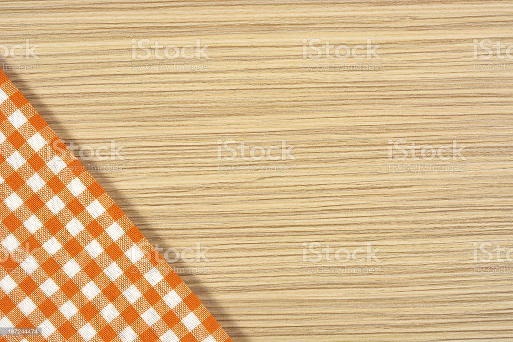Orange tablecloth on wooden table royalty-free stock photo