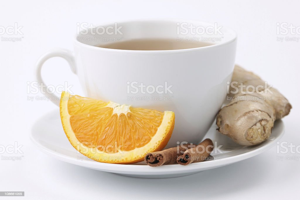 Orange tea with cinnamon and ginger royalty-free stock photo