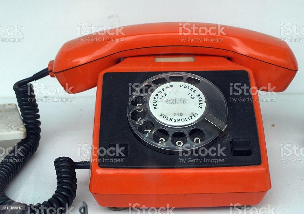 Orange Telefon aus der DDR stock photo