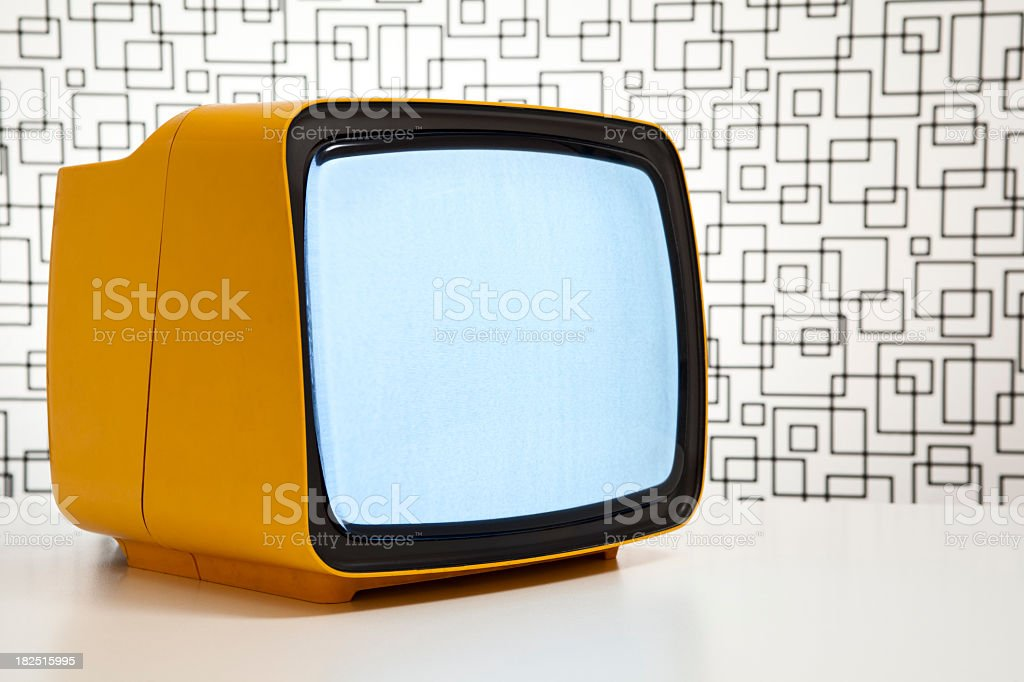 Orange television with a blank screen surrounded by patterns royalty-free stock photo