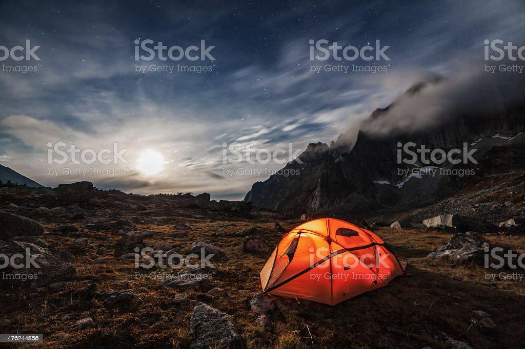 Orange tent in the mountains. stock photo
