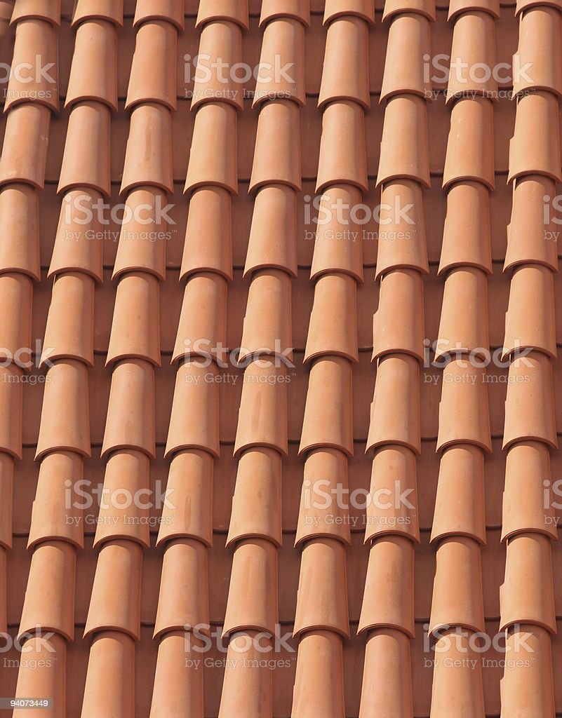 Orange tile roof forming some interesting designs. royalty-free stock photo