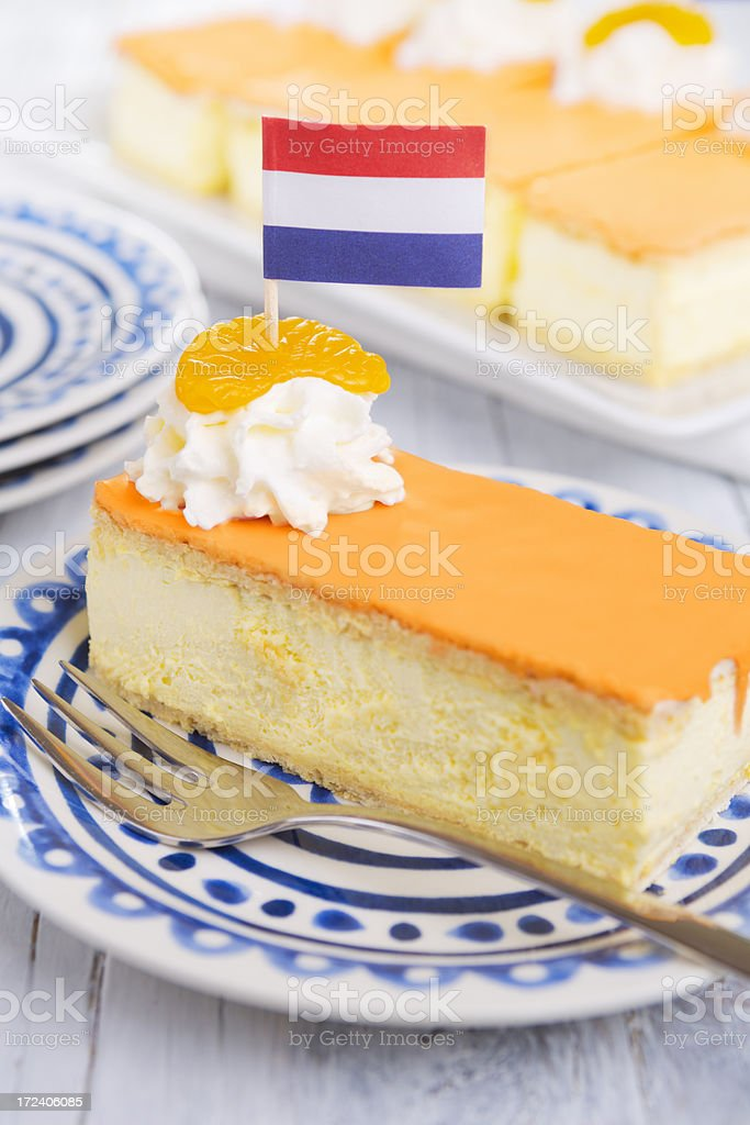Orange tompouce, traditional Dutch pastry, on a rustic table stock photo