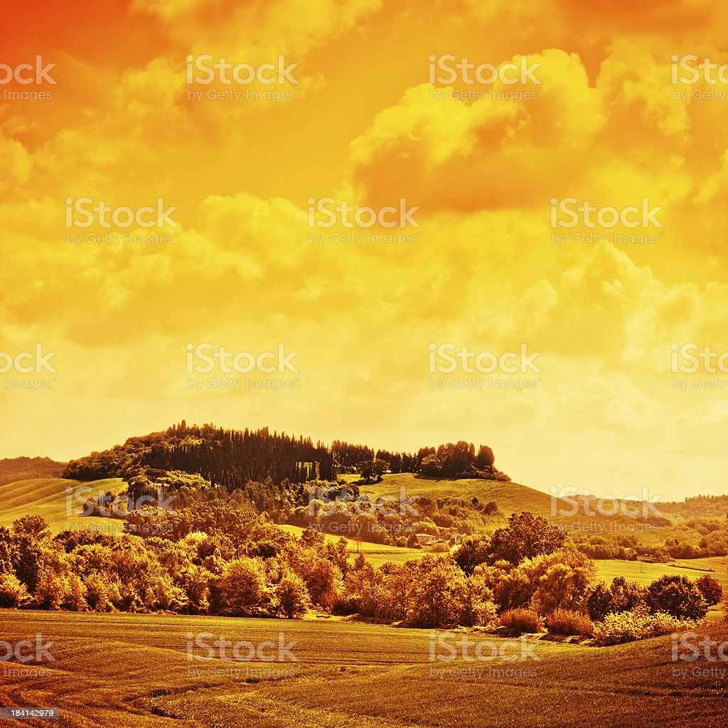 Orange Tones Tuscan Landscape, Val d'Orcia UNESCO World Heritage Site royalty-free stock photo