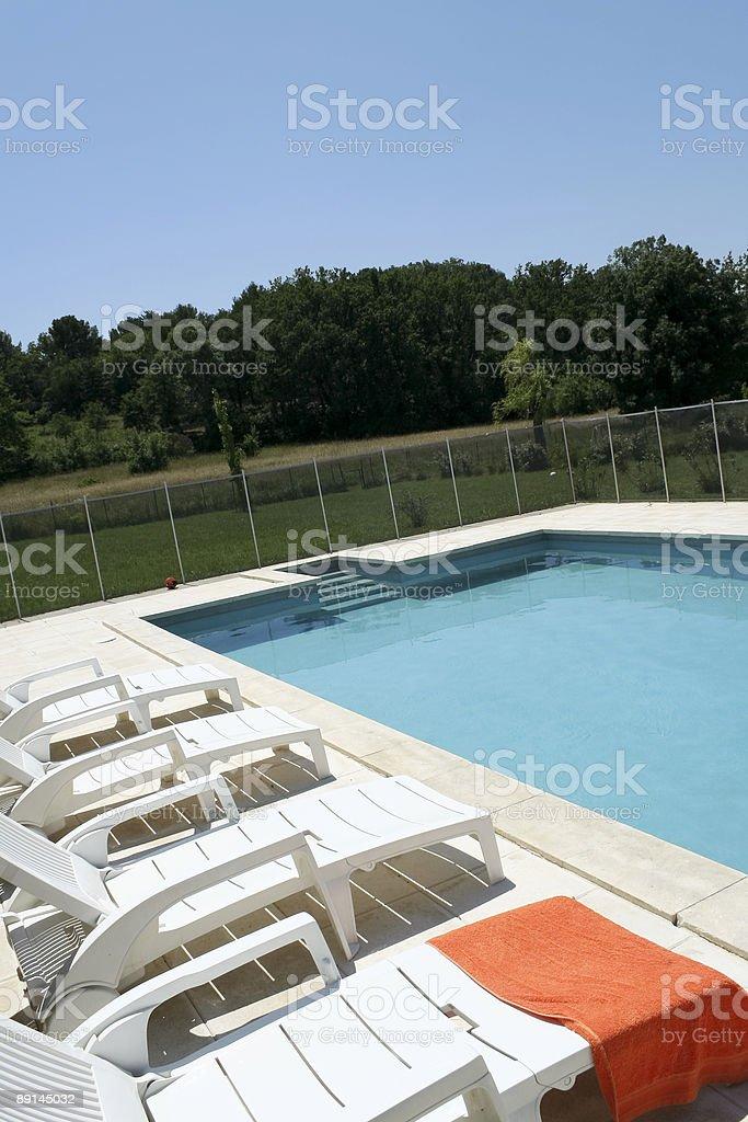 orange towel poolside royalty-free stock photo