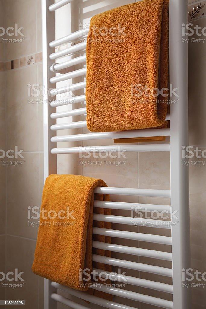 orange towels on heater royalty-free stock photo