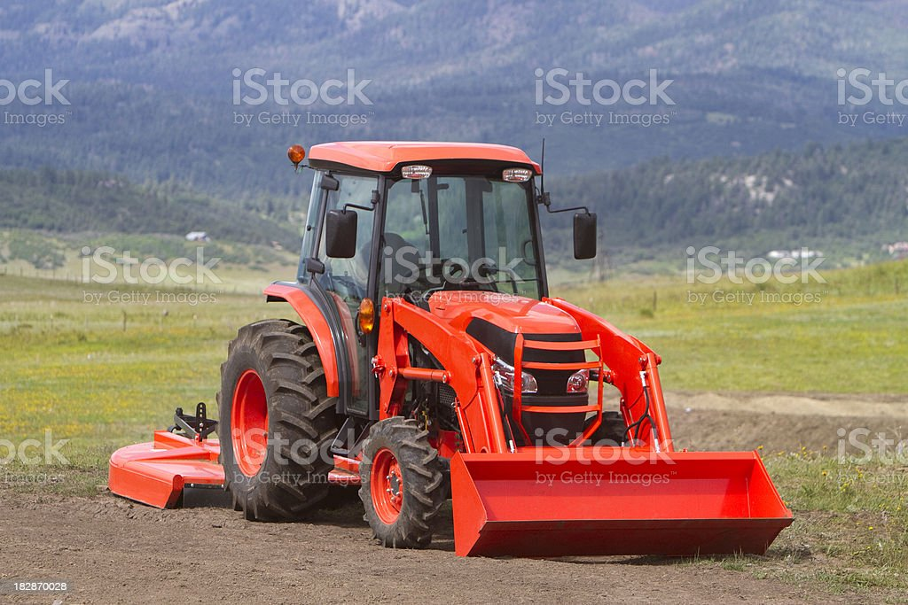 Orange Tractor royalty-free stock photo