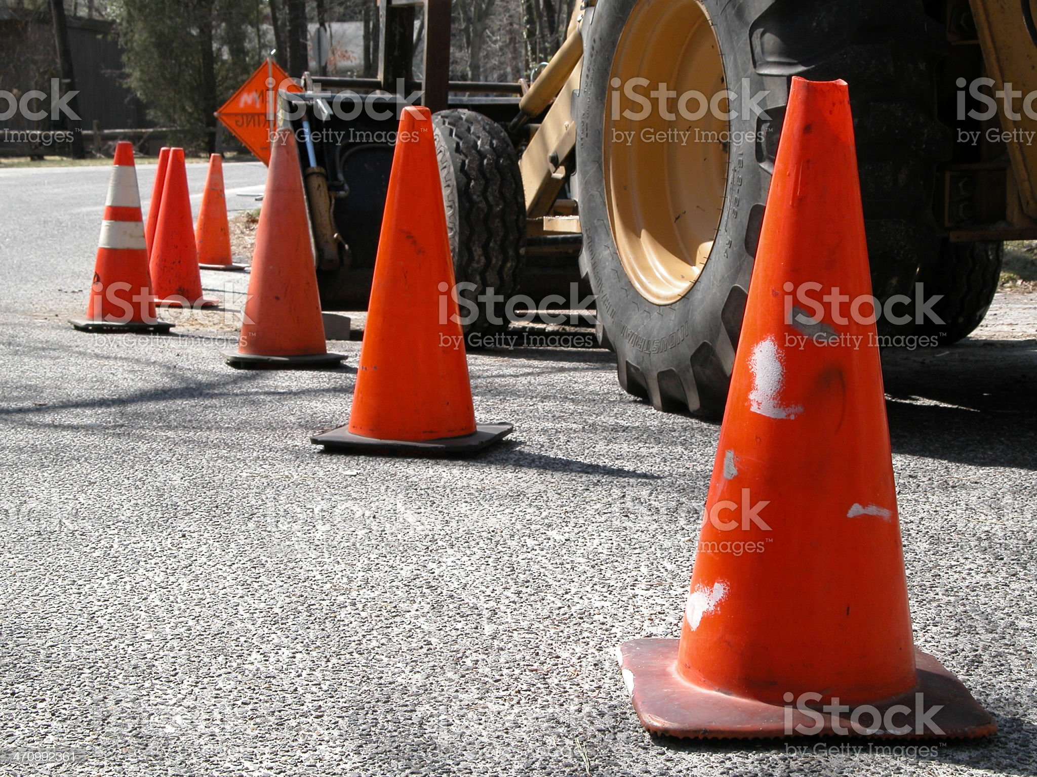 Orange Traffic Cones and  Construction Equipment royalty-free stock photo