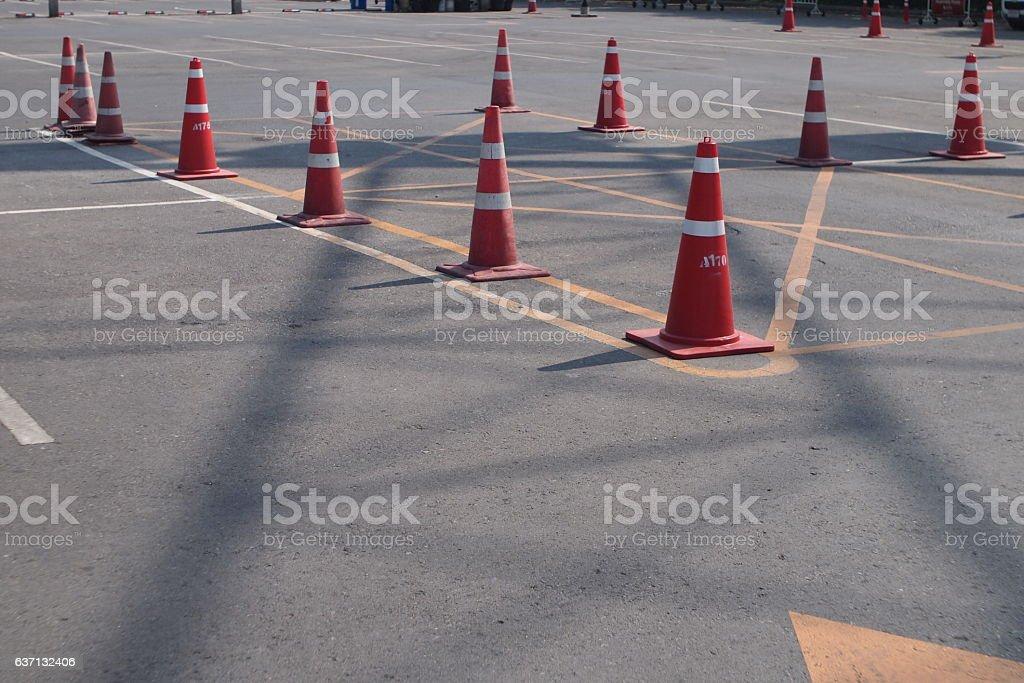orange traffic cones in parking lot stock photo