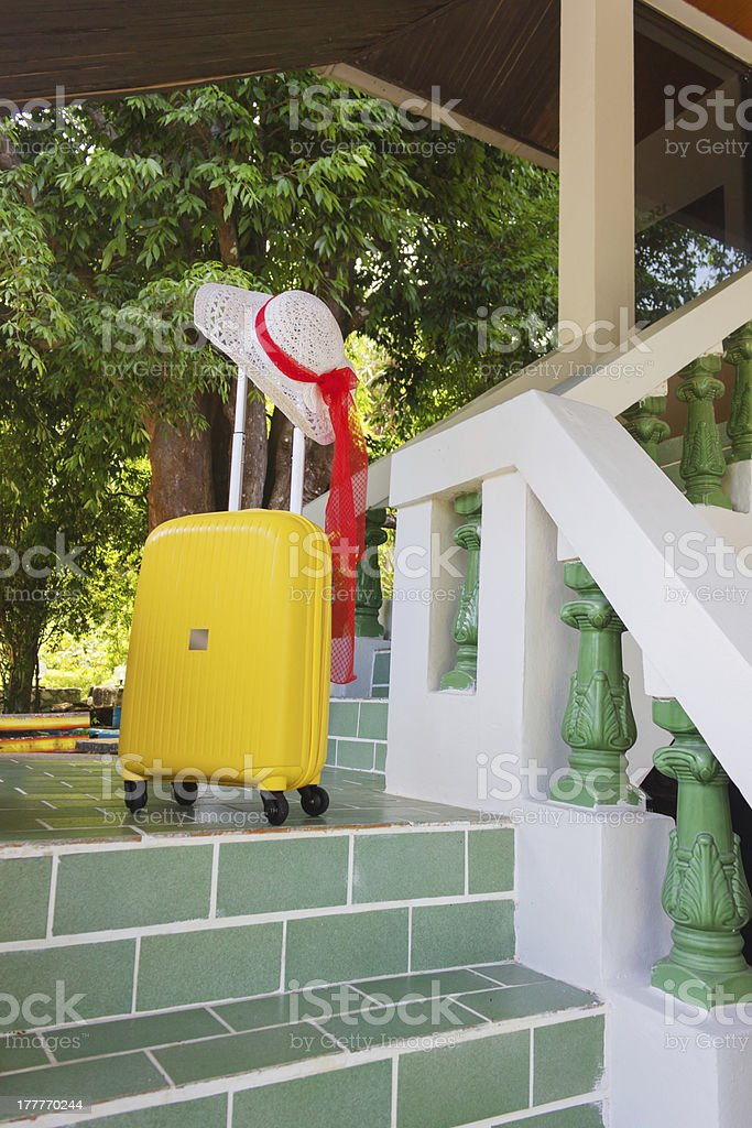 Orange travel case and sun hat royalty-free stock photo