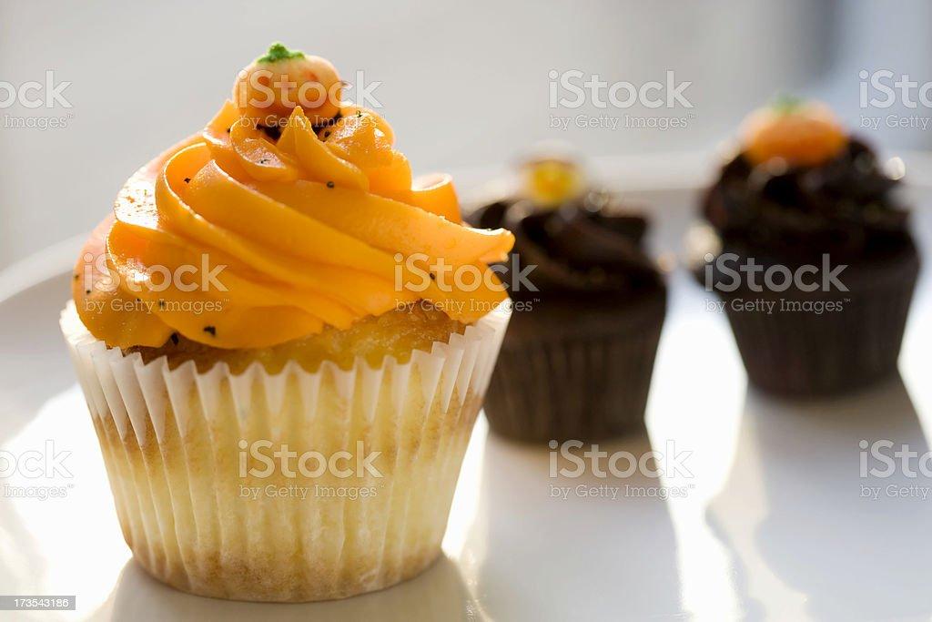 Orange vanilla and chocolate cupcakes for Halloween stock photo