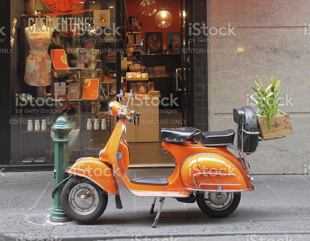 Orange Vespa motorbike stock photo