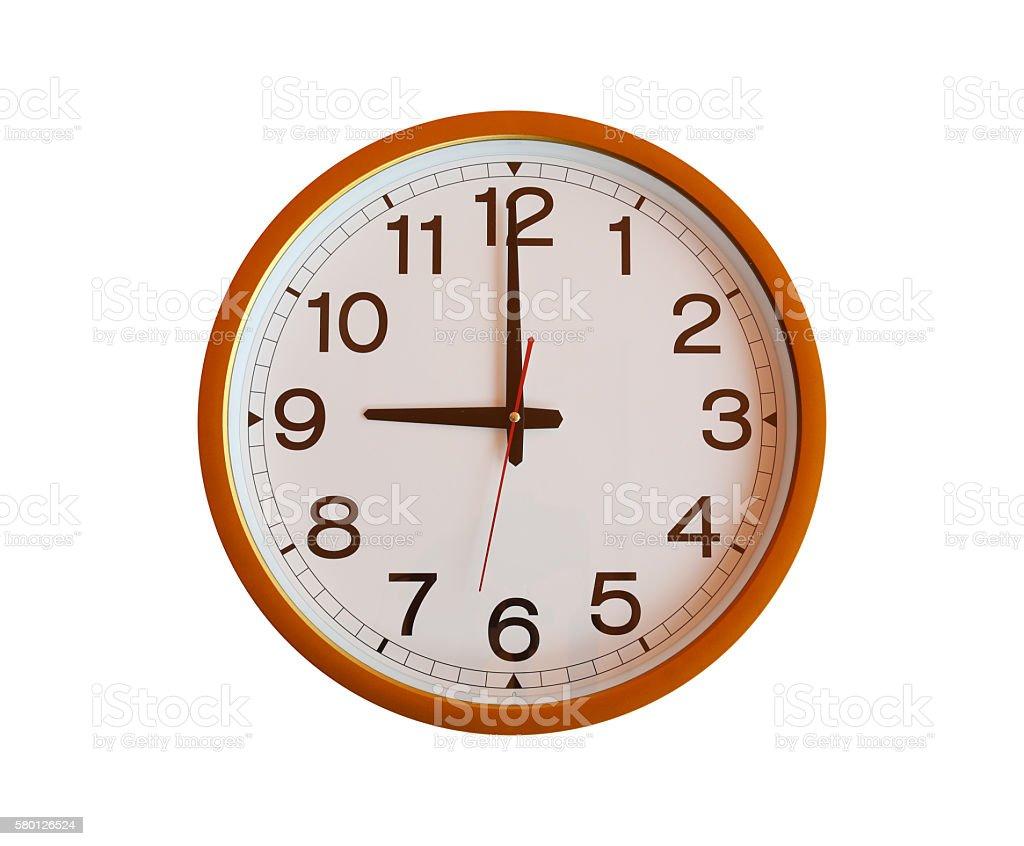 orange wall clock isolated in nine o'clock. stock photo