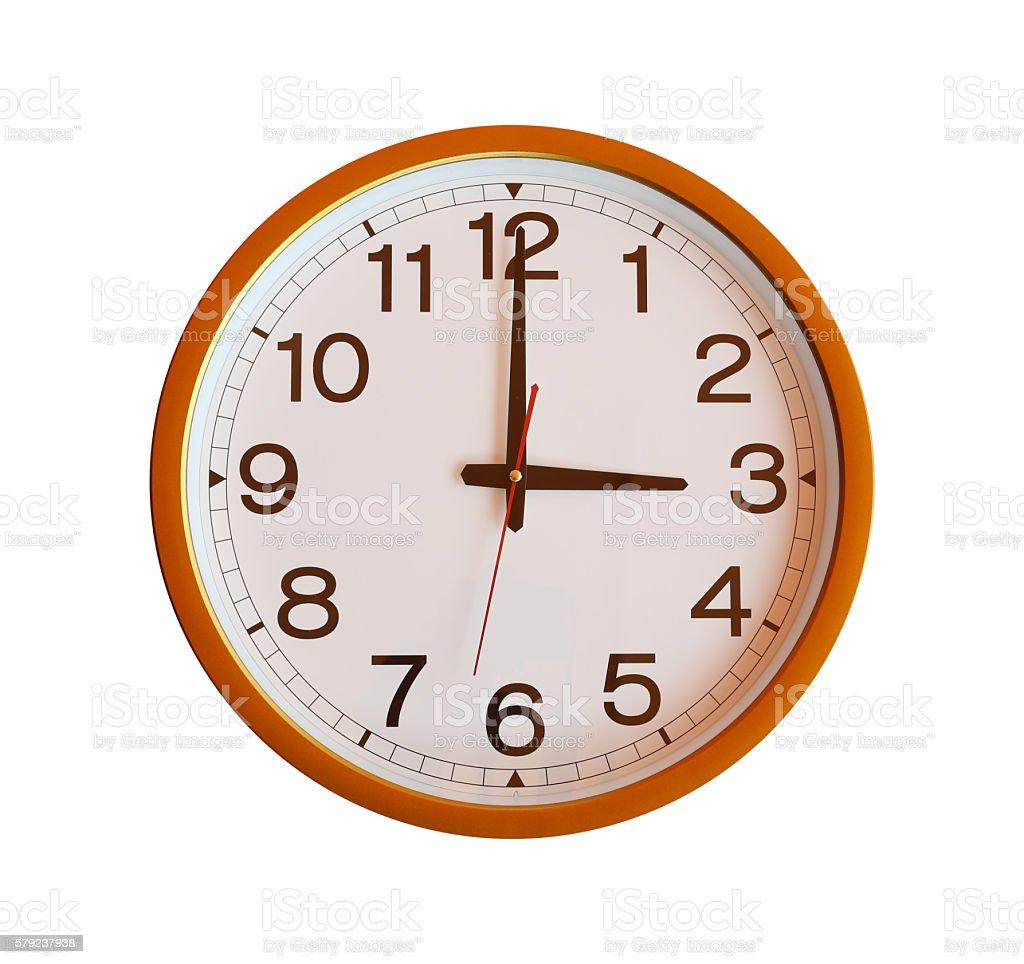 orange wall clock isolated in three o'clock. stock photo