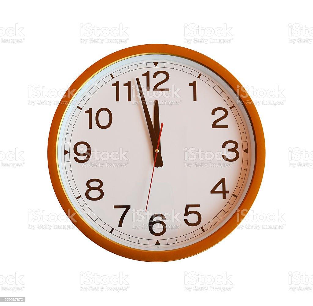 orange wall clock isolated in twelve o'clock. stock photo