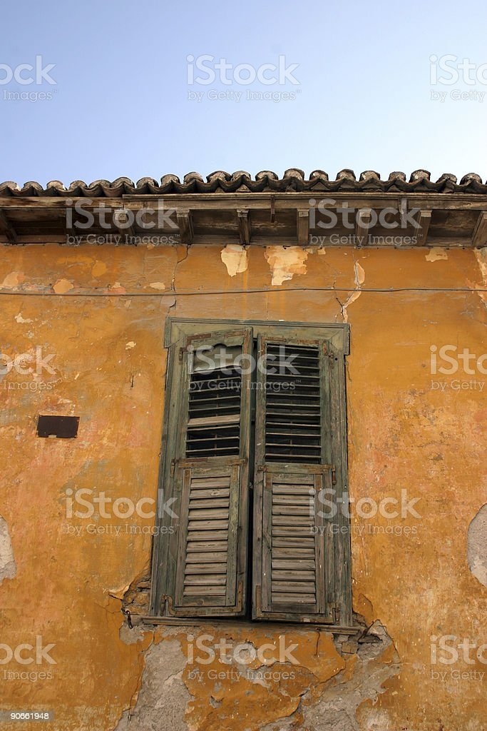 Orange wall with shutter royalty-free stock photo