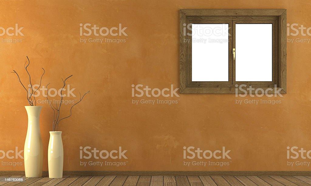 Orange wall with window royalty-free stock photo