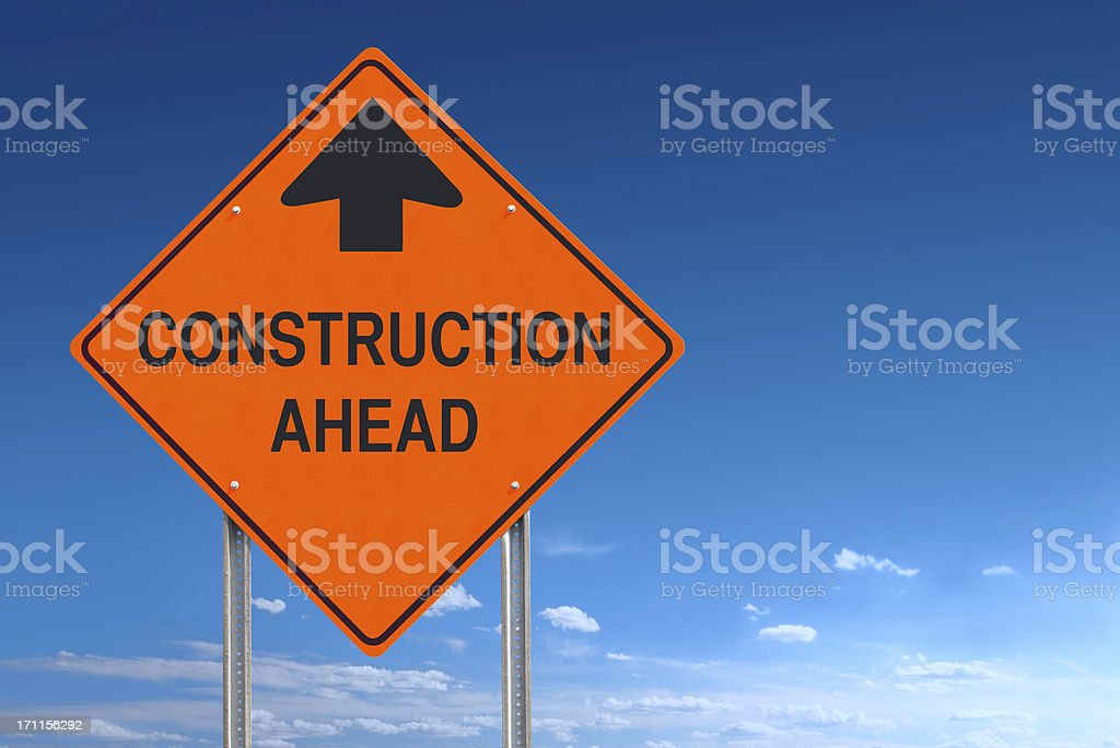 Orange Warning Construction Ahead Message Road Sign Over Blue Sky stock photo