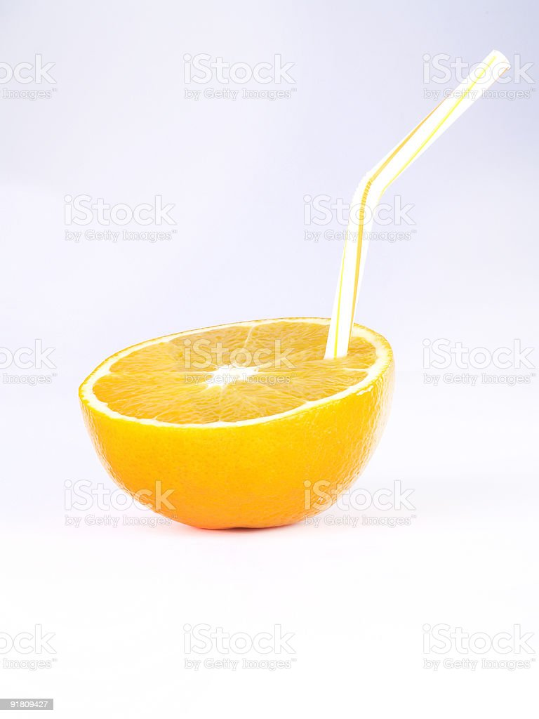 orange with a straw stock photo