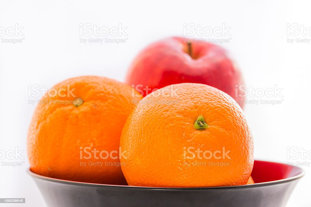 Orange with apple in the bowl. stock photo