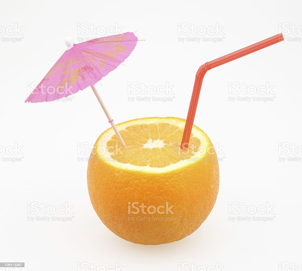 orange with drinking straw and umbrella stock photo