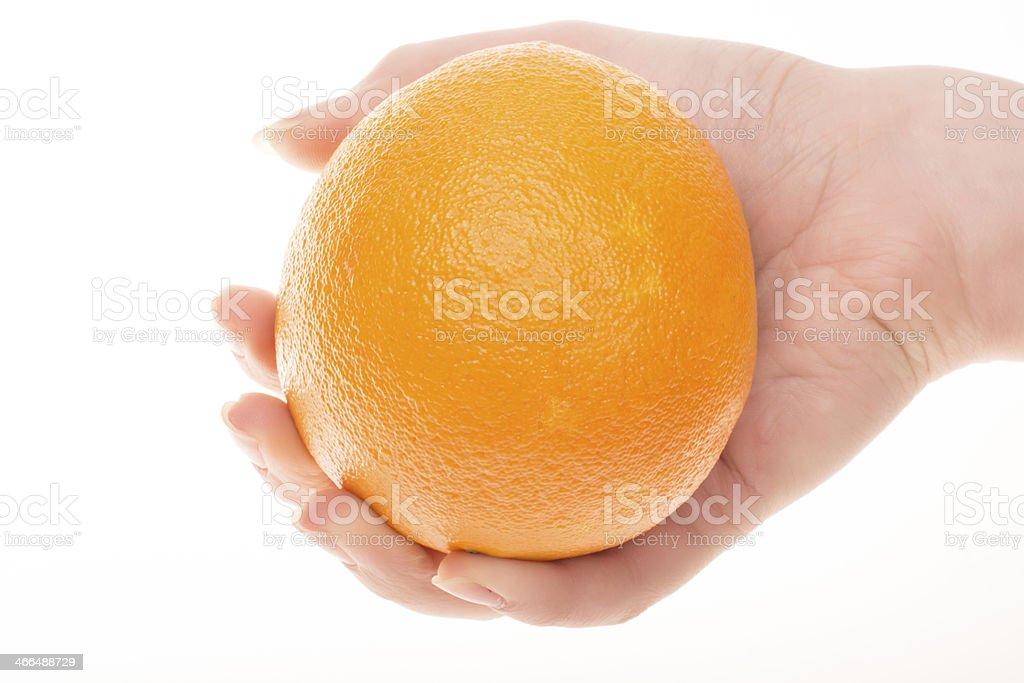 Orange with hand royalty-free stock photo