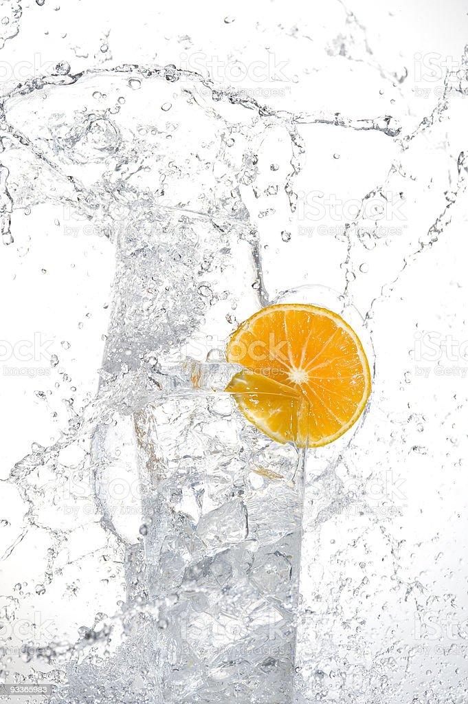 Orange with splashing water royalty-free stock photo