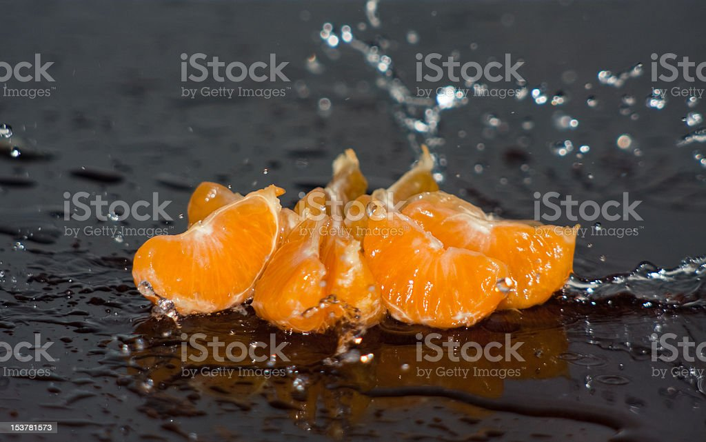 orange with stopped motion water drops royalty-free stock photo