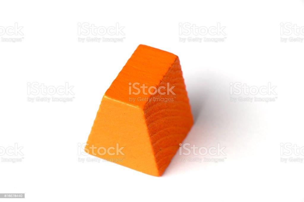 Orange wood trapezoid shape on white background stock photo