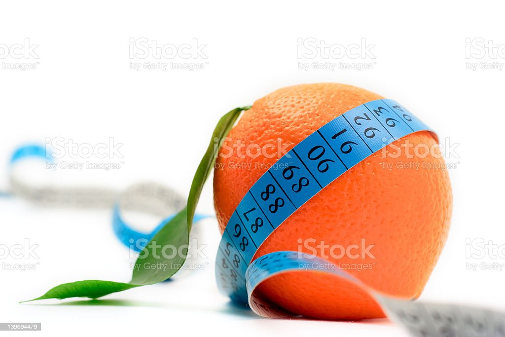 Orange wrapped around a tape against white background royalty-free stock photo