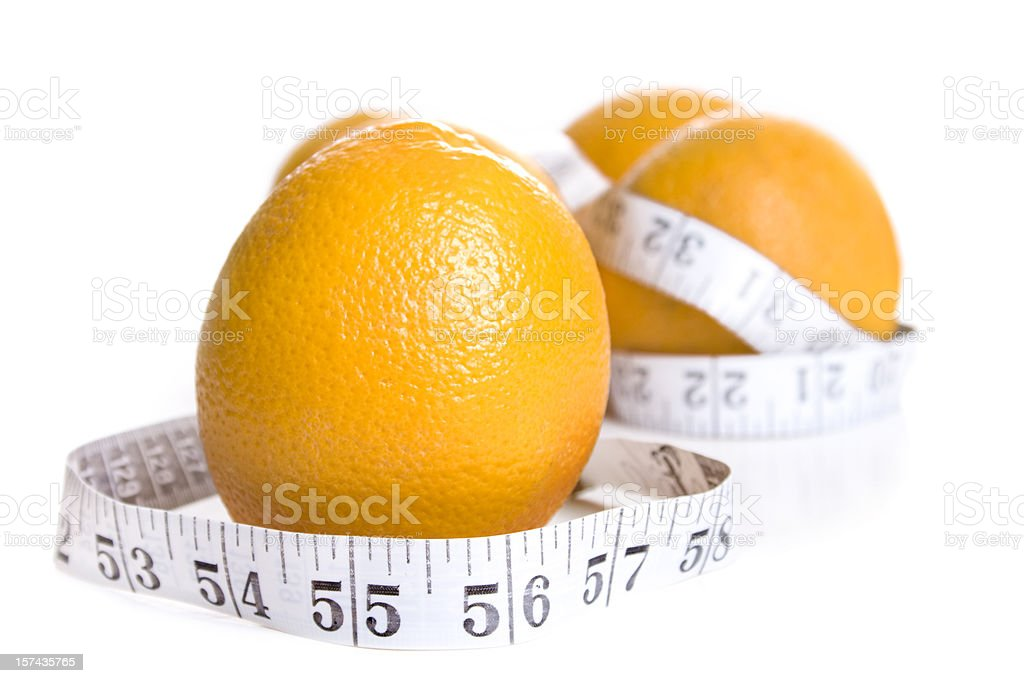 Orange wrapped in a measuring tape stock photo