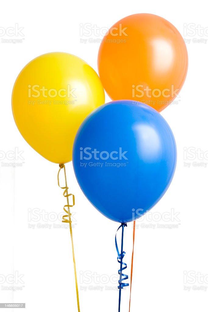 Orange yellow and blue balloons stock photo