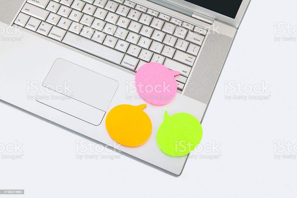 Orange yellow and pink speech on laptop stock photo