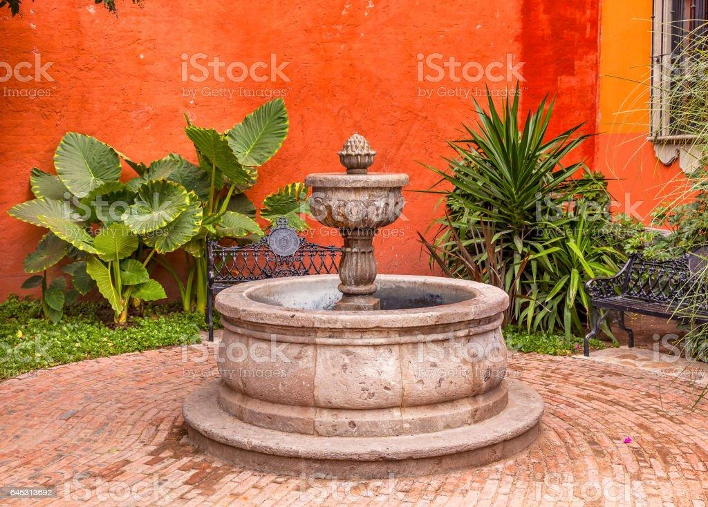 Orange Yellow Fountain Plaza San Miguel de Allende Mexico stock photo