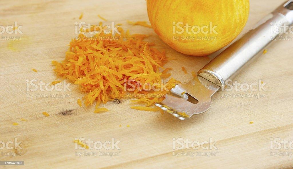 Orange zest and scraper stock photo