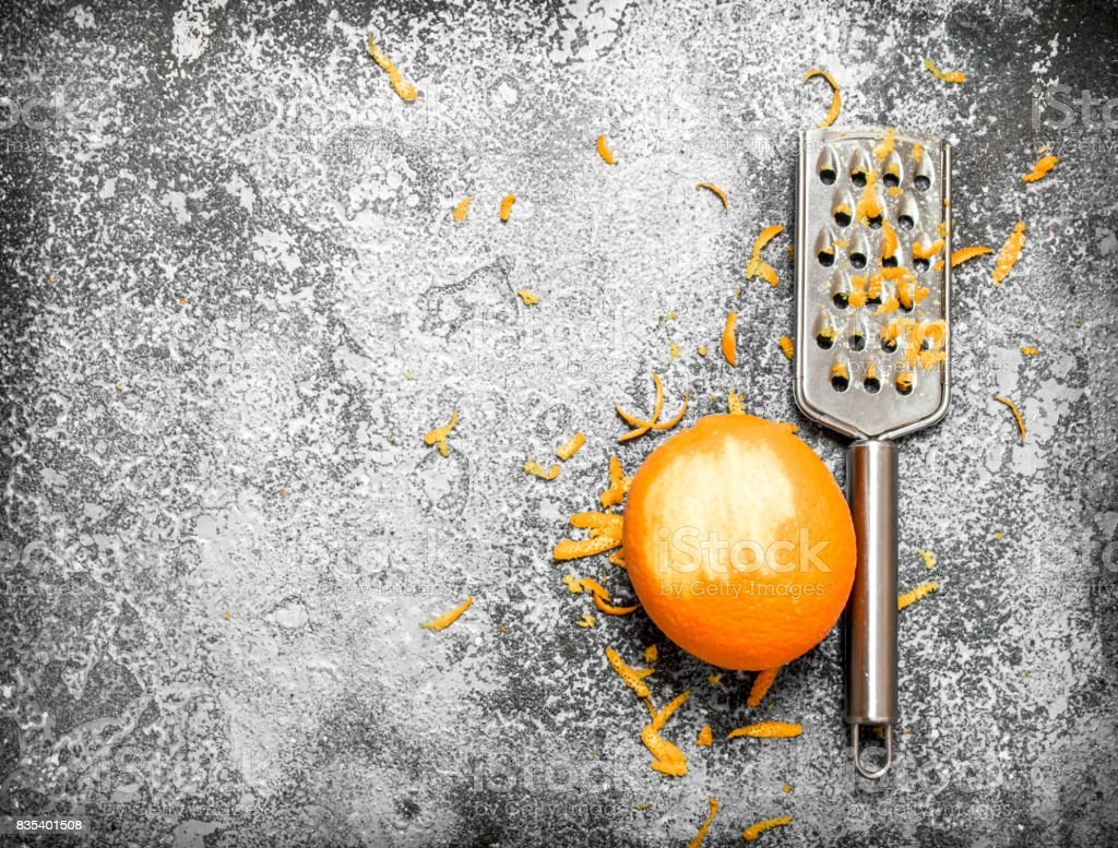 Orange zest with a grater . stock photo