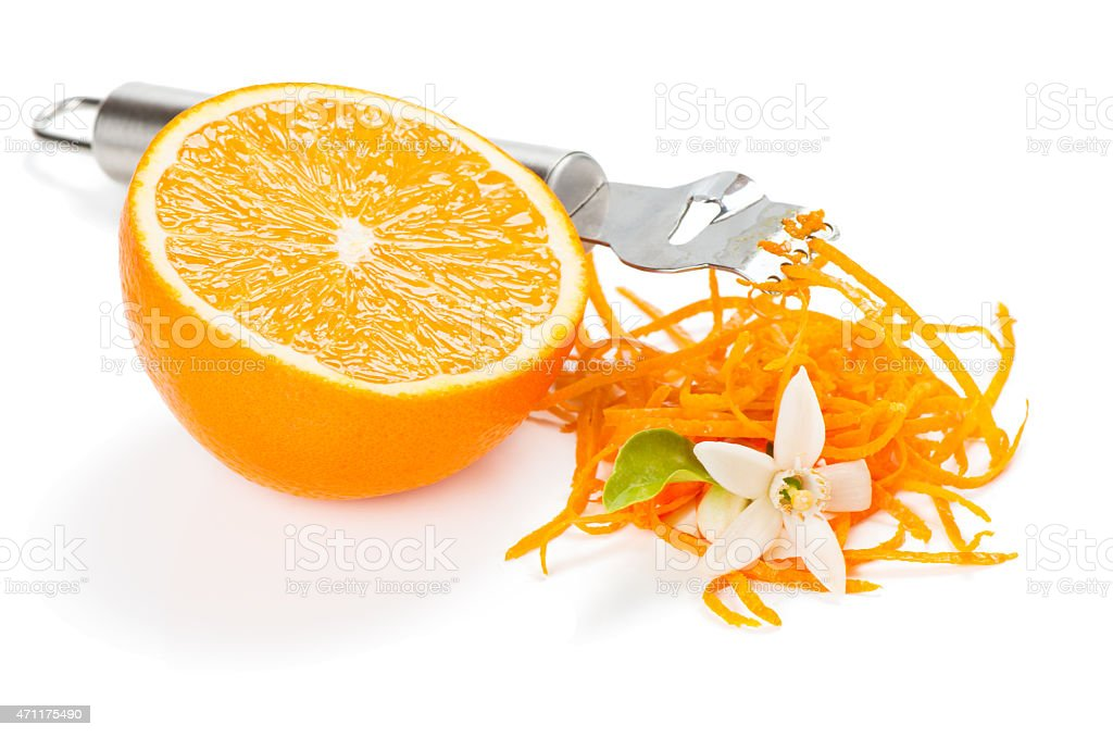 Orange zesting with flowers stock photo