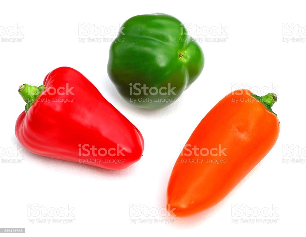 Orange,green,and red bell peppers stock photo